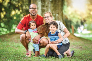 JFS Adoption. A family with adopted children poses for a photo.