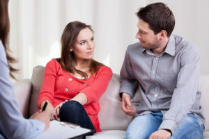 JFS Counseling - Getting Started. A couple talks during a counseling session.