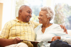 An affectionate JFS Care Senior couple at home together