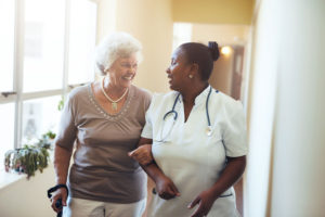 Careers at JFS Richmond. An RN assists an elderly woman.